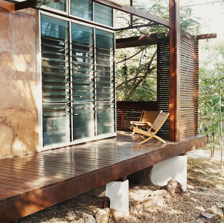 In This Ghanian Homeu0027s Exterior, Slatted Wooden Screens Afford Privacy And  Break The Short But Driving Rains That Blast The House From The Southwest.