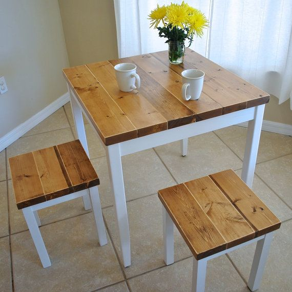 I love this table. We have a variation of it in our own breakfast nook. Its both rustic and beautiful. Can I say that about something I built? I think so, because it really is quite pretty. Perfect for a breakfast nook or small dining area. There are two sizes and you can order just the table or with two, three, or four stools. Thick solid spruce top with pine legs/aprons.  Table dimensions, CHOOSE FROM: 29 x 29 x 30H (pictured) or 35 x 35 x 30H  PLEASE NOTE: The table in the photographs...