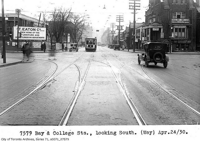Bay and College Streets, looking south by Toronto History, via Flickr