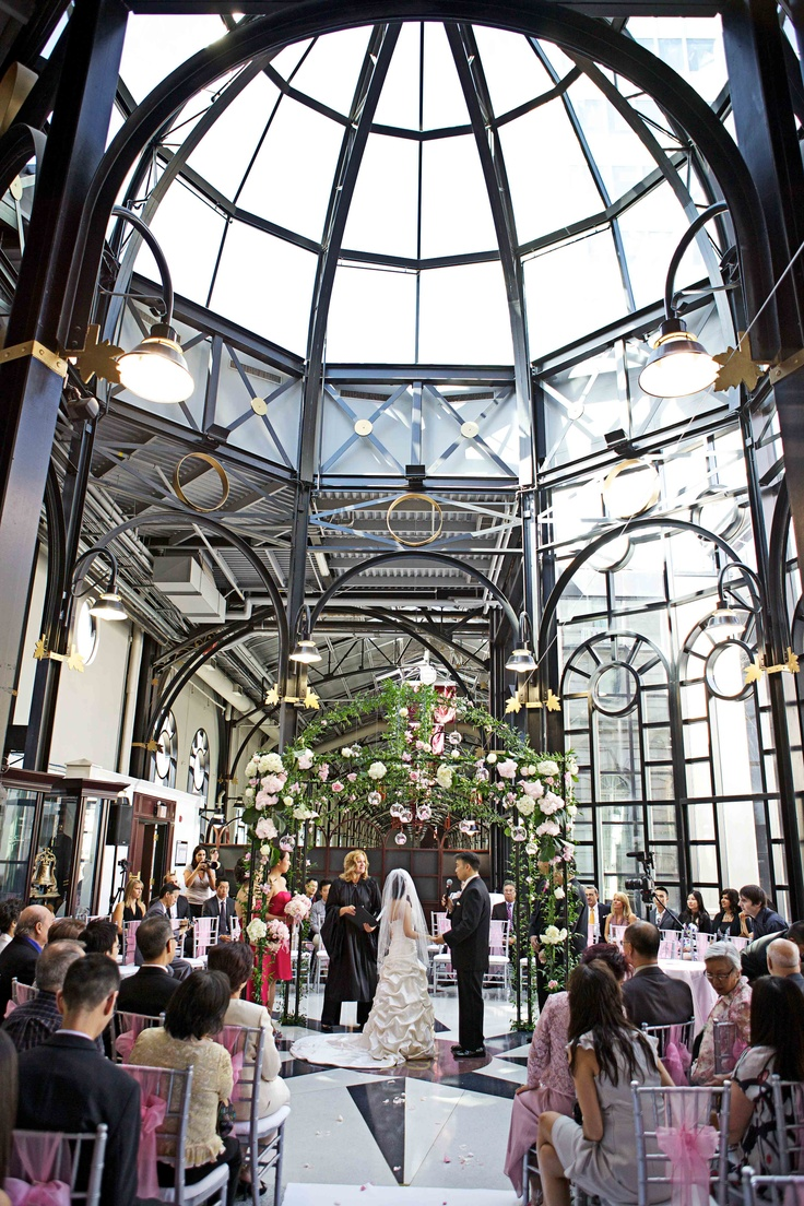 Wedding Ceremony at the Fairmont Palliser Hotel in Calgary, Alberta at the CPR Pavilion; ivy and flower covered gazebo a ceremony focal point (Photo by Andras Schram Photography)