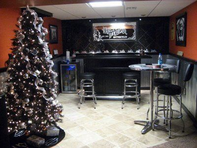 Harley Man Cave, This is my husbands ode to Harley Davidson/Crown Royal Man Cave., this was taken at christmas time. We have a black harley davidson themed christmas tree. Each year I add to it., Basements Design #HDNaughtyList