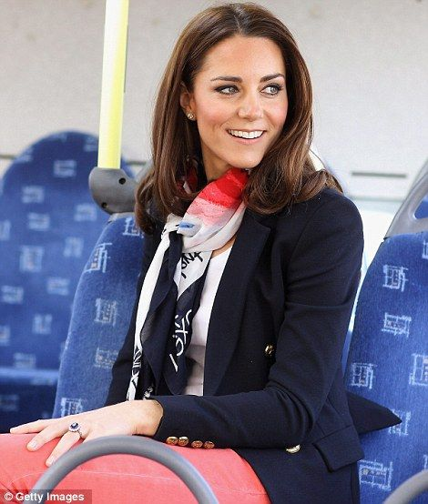 The Duchess was wearing eye-catching skin tight coral three quarter length jeans, blue heels and a smart blue blazer with an official Team GB supporters' scarf.