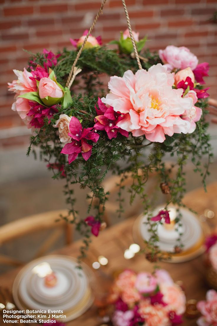 Gorgeous floral chandelier made with silk flowers! Perfect for any wedding. #fauxflowers  Design: Botanica Events Photo: Kim J Martin Venue: Beatnik Studios