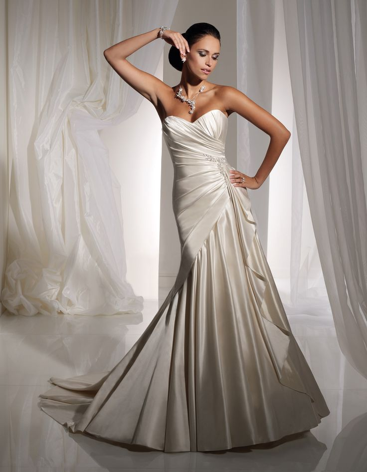 Popular Sophia Tolli Bridal Sophistication with a touch of glamour Leighanna bines traditional couture inspired draping with modern styling A slim A line gown