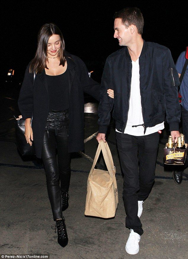 Love birds! Miranda Kerr, 32, couldn't stop smiling with new boyfriend Evan Spiegel, 25, as the pair attended Kanye West's concert atCalifornia's Hollywood Bowl on Saturday
