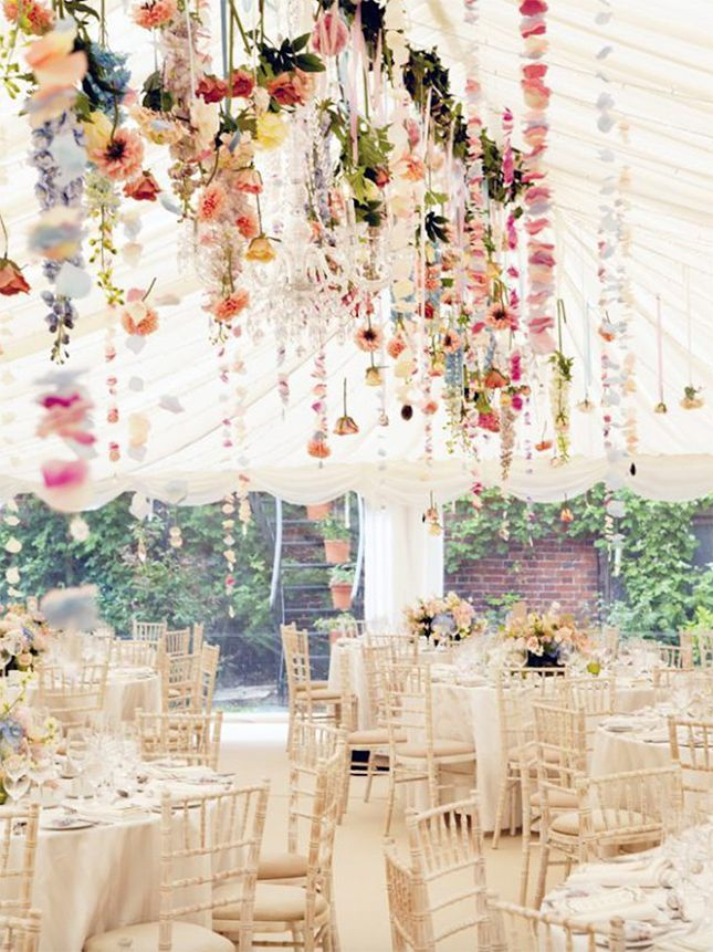 Hang flowers for an ethereal + colorful wedding reception.