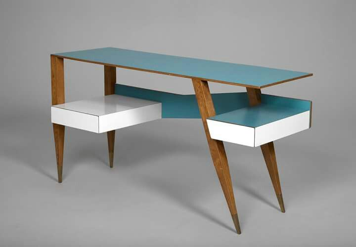 Striking desk designed by Gio Ponti. Made from ash, blue and white laminate with brass-covered feet it was produced by Cassina of Italy in 1954.