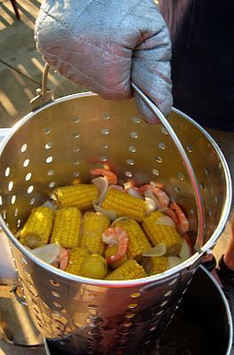 Shrimp boil recipe! Step by step instructions with cooking times for the perfect casual dinner party. The best part- no dishes to clean after!