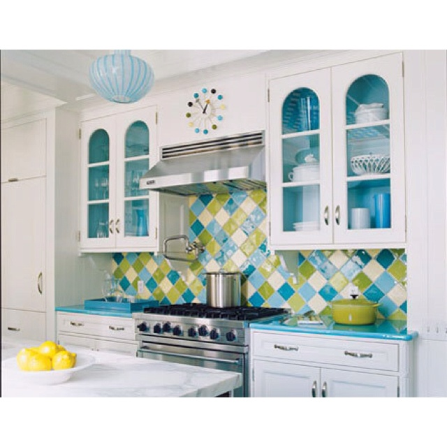 Blue and green kitchen Like colorful backsplash!  This would go so well with my green wall.  I wonder if I could paint the countertops that blue.