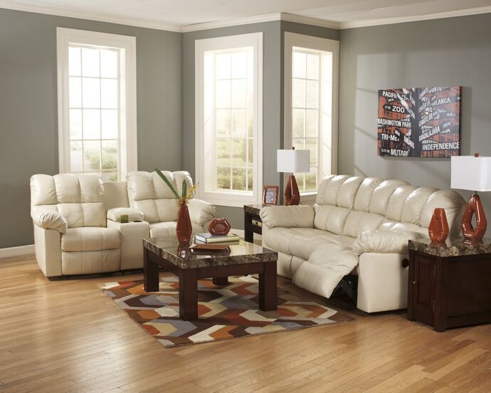 2 pc Kennard collection cream top grain leather match sofa and love seat set with console and standard motion recliners on the ends