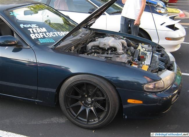 Nissan 240SZ (Silvia S14) with Infiniti VH45 V-8 engine swap. As shown at the August 2012 Cobb Tuning First Thursday event in Austin TX USA.