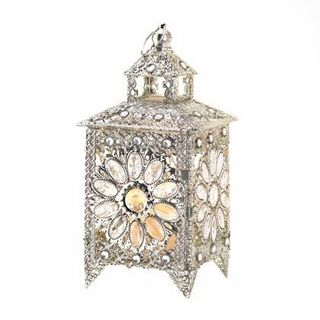 $49.95 - Live like royalty!   Enjoy the sparkle of all the riches in the kingdom that are gathered in this stunning tabletop candle lantern.
