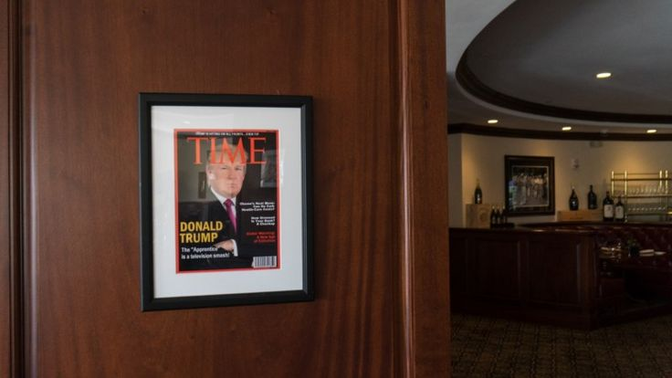"The framed copy of Time magazine was hung up in at least five of President Trump's clubs, from South Florida to Scotland. Filling the entire cover was a photo of Donald Trump.  ""Donald Trump: The 'Apprentice' is a television smash!"" the big headline said. Above the Time nameplate, there was another headline in all caps: ""TRUMP IS HITTING ON ALL FRONTS . . . EVEN TV!"""