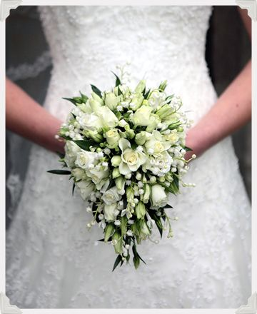 ivory teardrop bouquet of avalanche spray roses, ivory lisianthus, white bouvardia and lily of the valley