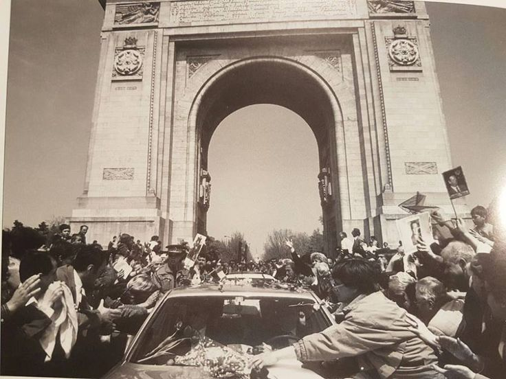 After 45 years of forced exile (1947-1992), HM King Michael of Romania arrives in Bucharest in April 1992 and, in an unprepared move, is driven under The Arch of Triumph (a Royal monument of 1922). ROMANIANS ASK FOR THEIR MONARCHY BACK! https://www.facebook.com/anrmro