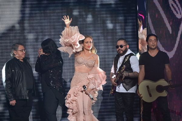 Jennifer Lopez Photos - Jennifer Lopez and Los Dinos onstage after performing musical tribute to Selena at the 2015 Billboard Latin Music Awards presented bu State Farm on Telemundo at Bank United Center on April 30, 2015 in Miami, Florida. - 2015 Billboard Latin Music Awards - Show