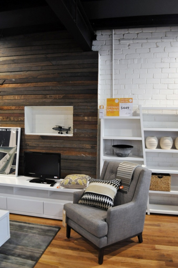 Oz design furniture. Lovin the recycled timber feature wall and the Carrie armchair