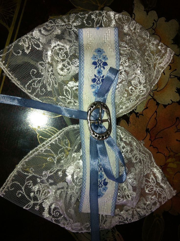 Lace facinator with buckle and ribbon sewn onto a hair clip