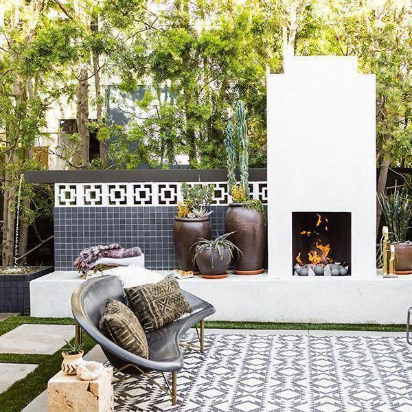 White Modern Outdoor Fireplace And Decorative Graphic Tile Outdoorkitchendesignslayout Outdoork Modern Outdoor Fireplace Backyard Patio Backyard Fireplace