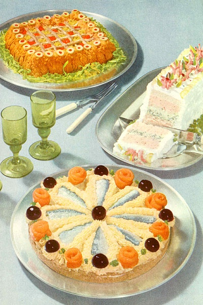 A selection of vintage delights, including an anchovy pate' party wheel and some sort of layered sandwich loaf. 1955.