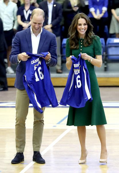 Kate Middleton Photos Photos - Prince William, Duke of Cambridge and Catherine, Duchess of Cambridge are presented with sport shirts on a visit to Kelowna University during their Royal Tour of Canada on September 27, 2016 in Kelowna, Canada. Prince William, Duke of Cambridge, Catherine, Duchess of Cambridge, Prince George and Princess Charlotte are visiting Canada as part of an eight day visit to the country taking in areas such as Bella Bella, Whitehorse and Kelowna. - 2016 Royal Tour To…