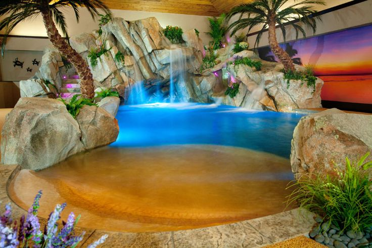 This residential indoor beach entry pool creates an at-home ...