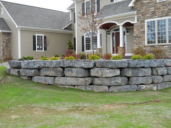 Landscaping St. Louis, gray boulder retaining wall.