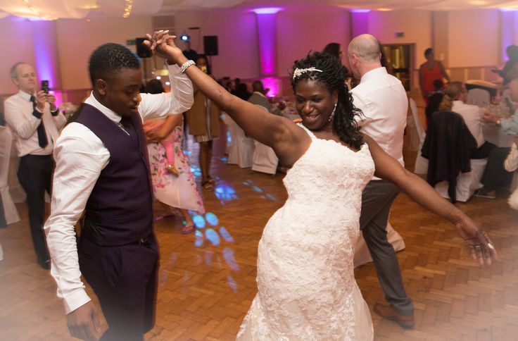 Bride dances with her son.Wedding photography for Abe & Marsha who got married at Oakley House Bromley June 2016