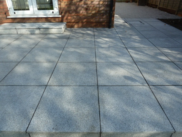 Silver Grey Granite: This paving is sawn on all sides with a flame textured top surface. Granite paving is hard wearing and ideal for use in modern contemporary designs.  Granite is speckled in appearance and consistent in colour' with little variation. This attractive silver grey paving is ideal for use both internally and externally.