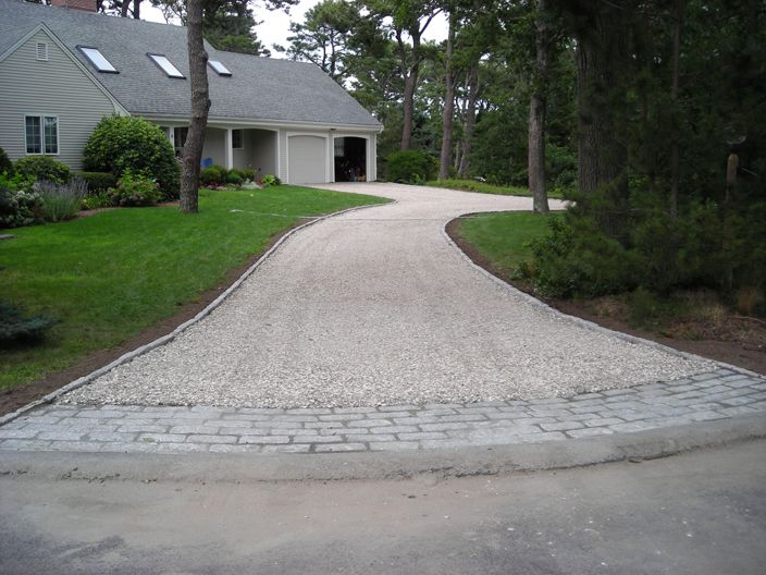 Cobblestone And Gravel Used Together On The Driveway