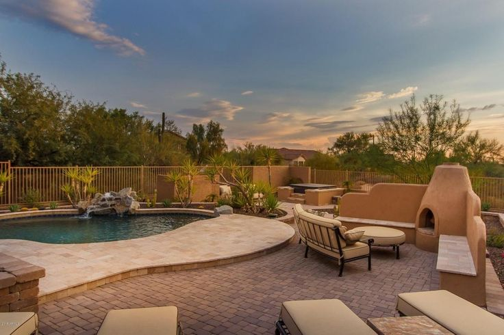 Southwestern Patio with Raised beds, exterior tile floors, exterior brick floors, Fence, outdoor pizza oven