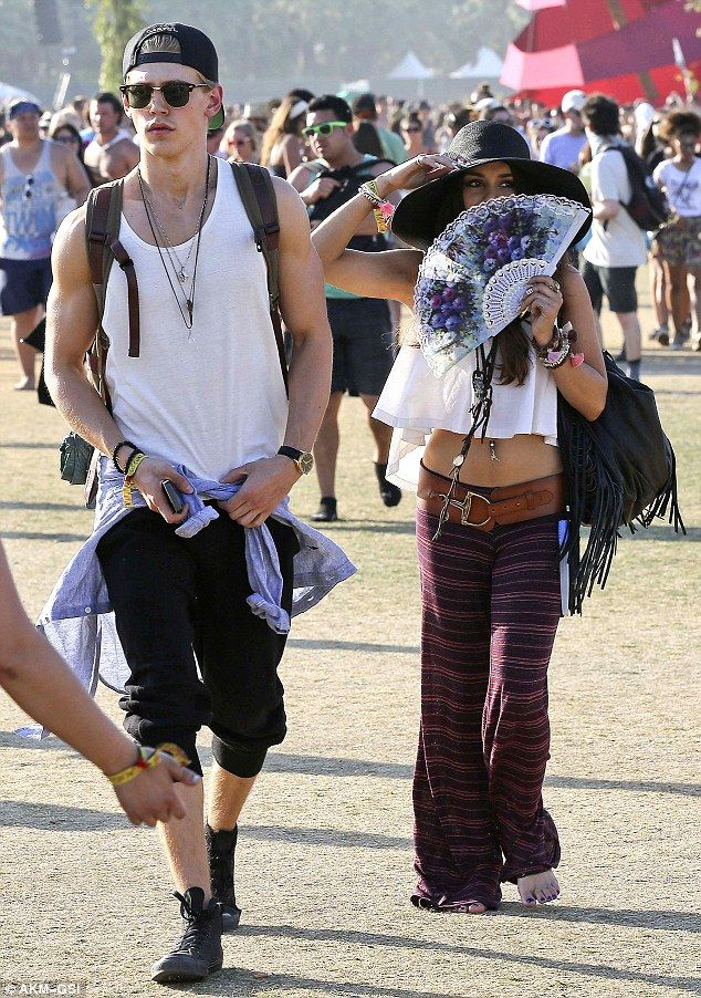 California cool: Vanessa Hudgens took a creative approach to hiding from the sun as she and her toyboy Austin Butler enjoyed some music at the Coachella Music Festival on Sunday