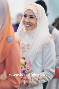 Irma Hasmie. White + Coral border & inner tudung. Bridesmaids/family members in coral outfit