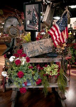 Old Primitive Display...with garden sign, birdhouse & flag.