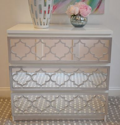 This is a plain ikea dresser hack refinished with mirror and O'verlays... Love this!