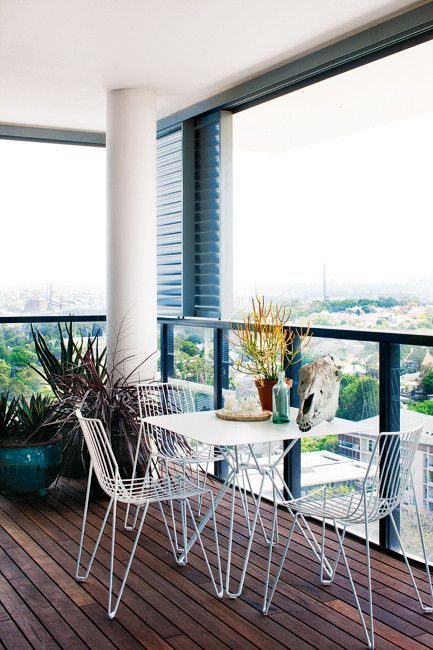 On the balcony: retractable screens protect the 'Tio' setting from Spence & Lyda.