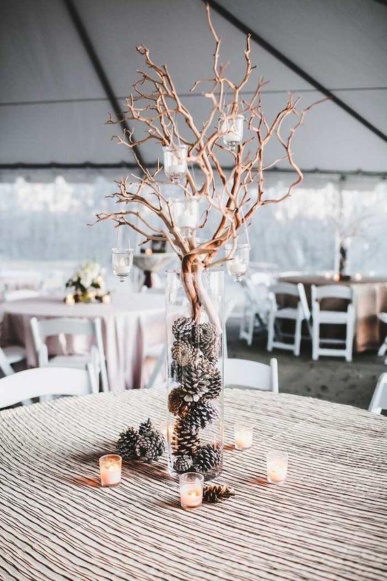 winter wedding centerpiece idea / http://www.deerpearlflowers.com/rustic-winter-pinecone-wedding-ideas/