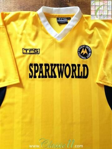 Official TFG Sports Torquay United home football shirt from the 2002/03 season.
