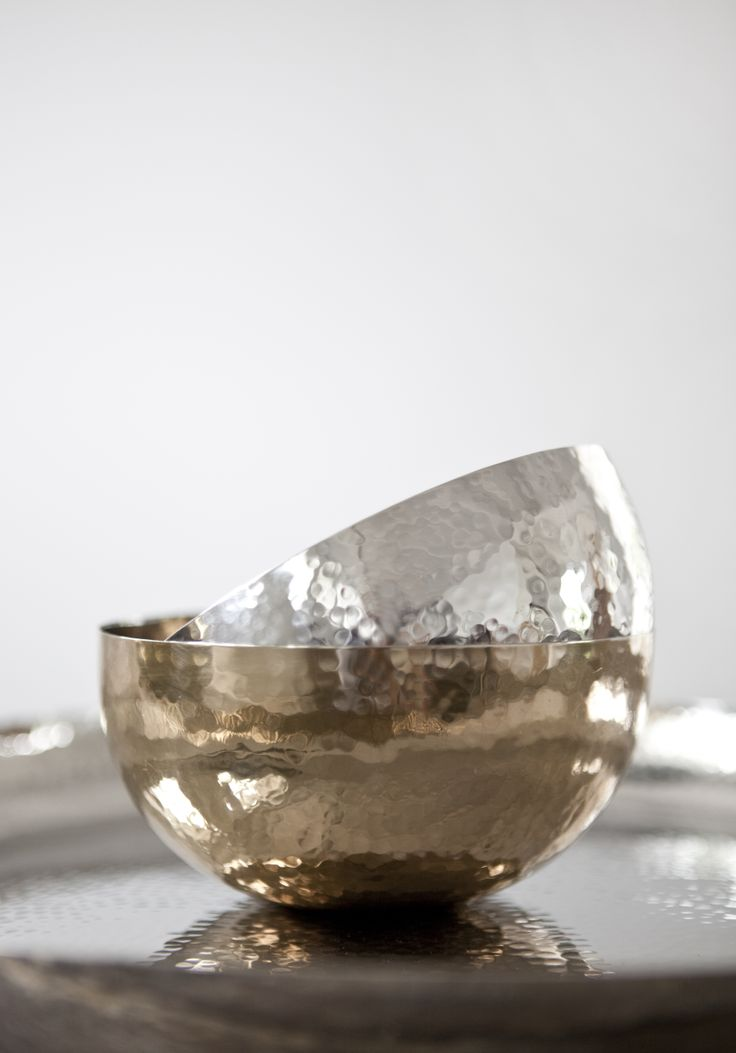 "Beautiful ""vice versa"" set of bowls. Hammerstroked metal in gold and chrome by Lisbeth Dahl Copenhagen. Spring/Summer 2014. #LisbethDahlCph #dustandsparkle #gold #silver"