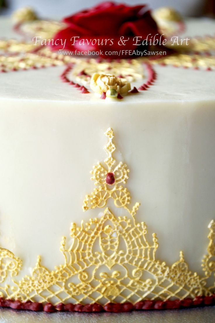 White chocolate, Red & Gold Asian/ Indian wedding cake detail shot | Fancy Favours & Edible Art -- #wedding #cake #Asian #Indian #indianwedding #asianwedding #gold #marsala #red #white #table #desserttable #tabledisplay #lace #jewelry #beaded #jewellery  #piping #elegant #floral #flowers #rose #petals #henna #sugarart #sugarflowers #ornate #fancy #ffeabysawsen #chocolate #whitechocolate  #handmade #custom #customcake #weddingcake #styled #weddingstyle