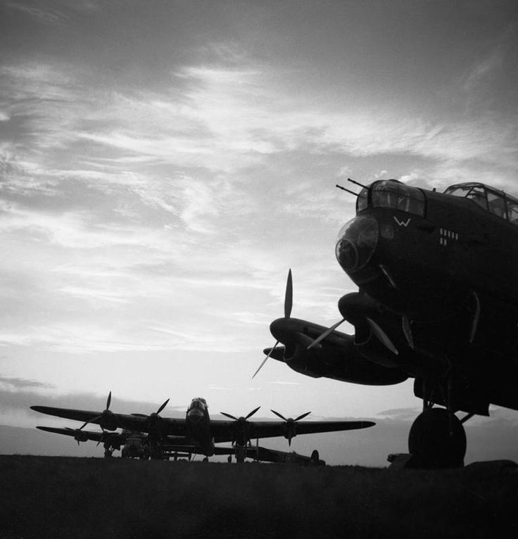 Avro Lancasters of No. 57 Squadron lined up at dusk before an operation, Scampton in Lincolnshire, February 1943.