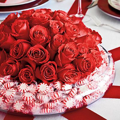 Peppermint Candy Christmas Centerpiece   For the centerpiece, place a low bowl of roses in a larger bowl and fill in between with mints.  This idea could be adapted for another occasion  by changing flowers and candy.For Easter fill with tulips and daffodils for the center and jelly beans in the outer bowl.