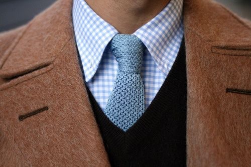 Nice combination of tie and shirt. Pale blue goes nice with this coat.