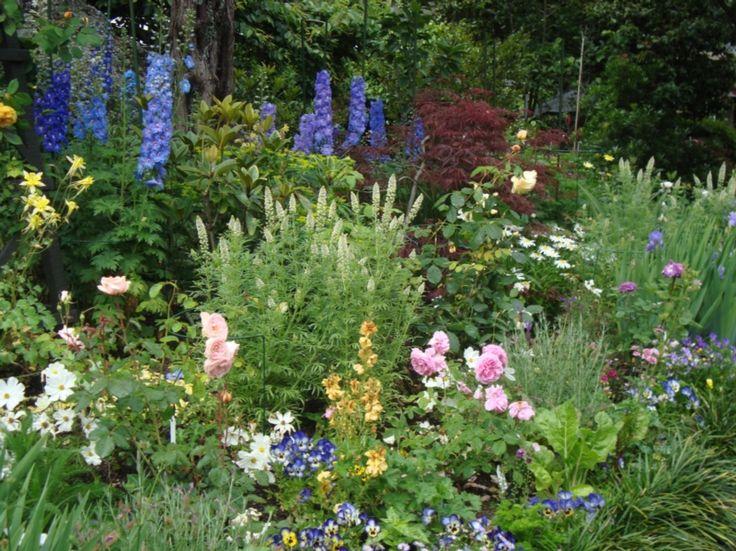 Eden Garden - Delphiniums and Roses