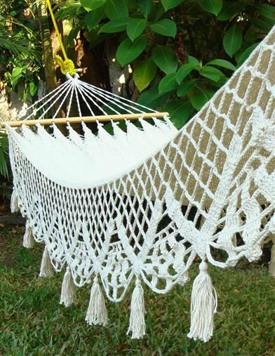 Bring an intriguing novel and frosty iced tea...the soothing to and fro of this beautifully fringed white crochet hammock will lull one into a restful state of serenity.