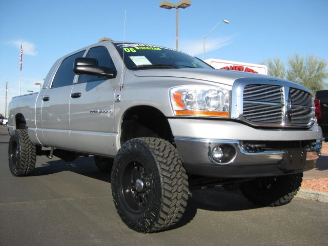 Dodge Ram Truck silver lifted oversize tires