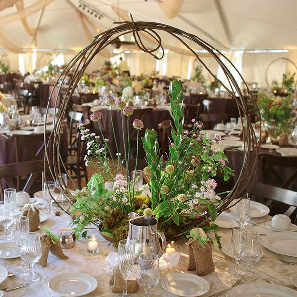 Encircle your arrangement of wildflowers and greenery with curved branches.
