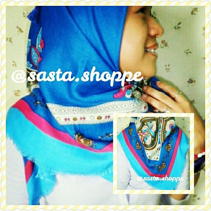 a square bright-blue scarf with blue tassels. follow our IG @Sasta.Shoppe for further info.