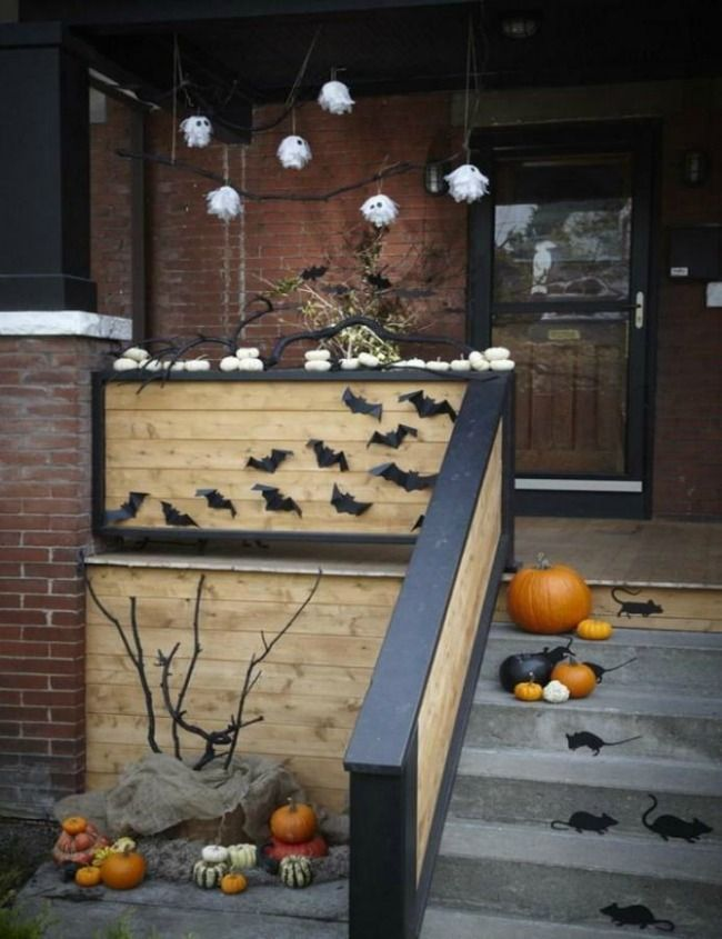 via HGTV, 20 Fabulously Spooky Halloween Front Porches via A Blissful Nest