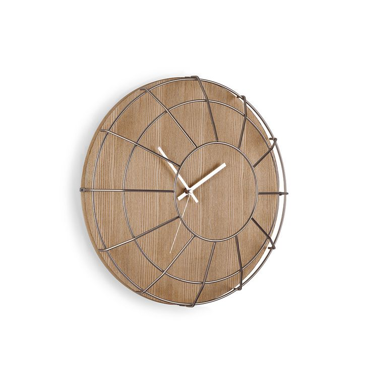 Add retro design to the home with this Cage wall clock from Umbra. The clock face is made from wood for a natural touch and is finished with a metal cage cover with an opening to read the time clea...